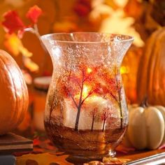 Decorate your home with the rich, warm colors of the falling leaves and our Hand-Painted Tree Hurricane! Ideal for pillar candles, the crackle glass finish of this hurricane refracts the shimmering candlelight.