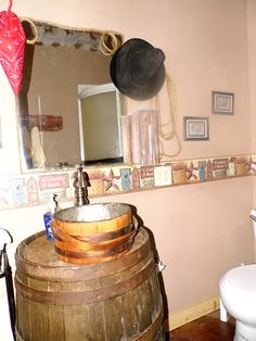 guest bath vanity from old wooden barrel and sink made from antique wooden bucket sealed and drilled