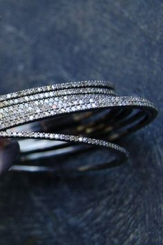 RONA PFEIFFER Thin Diamond and Sterling Bangle 1.6cts. each, 899 USD each   ***STAFF PICK!*** Beautiful Vintage inspired bangles that can be a delicate addition to your wrist, or pair it with the Lady Grey Bone Bangles to add more sparkle. From Victoria's Top 10.