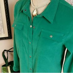 Sag Harbor snap front top Just a gorgeous shade of teal green that snaps down front, snap front pockets and at wrists. A really excellent almost suede look fabric that is 97% polyester and 3% spandex. Bust is 21 across, length is 28.5. Satiny lining. This looks great with a white tshirt and dark jeans, but a great holiday color also. Worn a couple times, very good condition. Sag Harbor Tops Blouses
