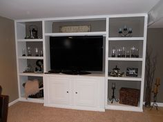 DIY Entertainment Center, however they should have painted the back the same color as the entertainment center to make it look truly built in.