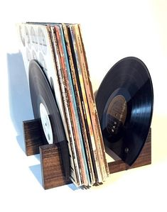 Vinyl Record Holder Handmade original vinyl holder made with reclaimed wood and reclaimed vinyl records. Holds 30-40 records. 12 x 10 x 9 If you have any custom requests or questions, please feel free to contact us at anytime! Custom orders are welcomed