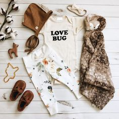 Baby boy, baby girl, baby clothes, onesie, onsie, onzie, boho baby, bodysuit, layette , newborn, infant, love bug love quotes, new baby quote, baby blanket fur cuddle blanket, floral flower white fall leggings for baby, brown mustard lace bonnet, leather moccasin Mary Janes, teething necklace, teething animal shape toy, white tan lace bow for baby girl, gender neutral unisex onesie bodysuit, pregnancy announcement onesie, baby shower gift for mom to be.