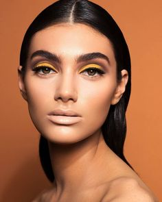 Try one of these chic ways to wear yellow eye makeup.