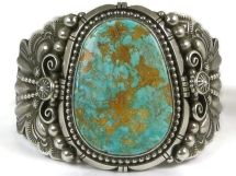 Natural High-Grade Royston Turquoise Bracelet By Navajo Silversmith, Fritson Toledo from Southwest Silver Gallery. Beautiful two-tone shades of turquoise with an earthy brown to golden matrix.