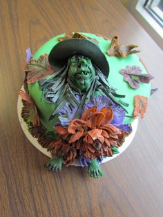 This is a cake I made in the Course 3 Cake Decorating Class at Hobby Lobby in Danville Va. Pam Boyd was the instructor. All the decorations on the cake are fondant. Witch Hat I made a pattern out of paper then cut out with fondant. Leaves cut from cookie cutters. Veined with tools and painted then dusted. So much fun. Feet, hands, legs and face carved from fondant. Then painted antique style to show details. Hair cut strips of fondant. Flowers are made with the Wilton technique. Cake Decorating Classes, Wilton Cake Decorating, Halloween Cakes, Halloween Treats, Wilton Cakes, Fondant Flowers, Pinterest Board, Hair Cut, Hobby Lobby
