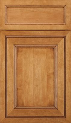 Carved details and depth define the Braydon Manor cabinet door style, available in various cabinetry wood types and finishes from Decora.