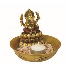 Ganesh tealight to go with my Ganesh incense burner. :)