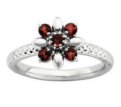 This stackable ring is decorated with a burst of round garnet gemstones set on a sterling silver band. Metal Jewelry, Sterling Silver Jewelry, Gemstone Jewelry, Gold Jewelry, Silver Earrings, 925 Silver, Diamond Jewelry, Jewelry Rings, Garnet Jewelry
