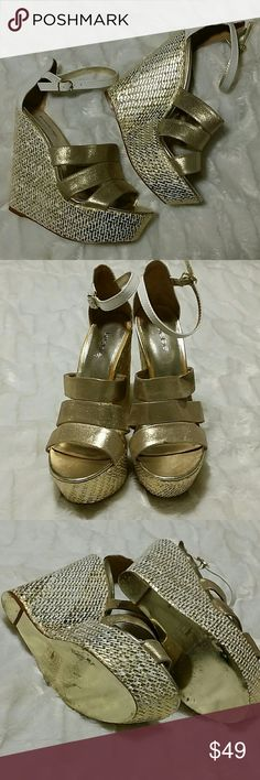 BEBE Platform Wedges Size 9 worn maybe once. Stunning gold and white platform wedges. Minor scuffs (very minor) to the white leather. Bottoms are still a beautiful shiny gold. Bundle to save or I will consider reasonable offers. bebe Shoes Wedges