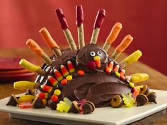 Turkey Cake. Guests will gobble up this devil's food delight! Create a delicious Thanksgiving centerpiece that kids will love to decorate with candies. Print out these detailed instructions and use it as a guide.