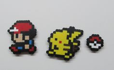 SET of 3 Pokemon Pixel art  - Ash Ketchum, Pikachu & pokeball - Magnet, wall hanging, keychain, hair clip, pin, Holiday ornaments. $13,00, via Etsy.