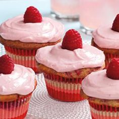 Healthy Raspberry-Swirl Cupcakes-- Make these beauties for your next summer event. Topped with fresh raspberries they will be the hit of the party! @EatingWell