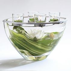 "Clearly Creative™ Elevated Votive Centerpiece - Dramatic modern shape! Artisan blown glass vessel awaits your own creative fillers. Add tealights or votives, sold separately, to the glass cups in the silver-tone metal topper for a twinkling centerpiece display. 7¼""h, 12¼""w. http://www.partylite.biz/legacy/sites/nikkihendrix/productcatalog?page=productdetail&sku=P91391&categoryId=58466&showCrumbs=true #green #leaves #waterlily #candles #centerpiece #wedding #shower #partylite"