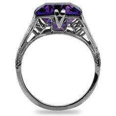 The Mariposa Ring  A bright natural amethyst showing strong purple color crowns this luscious 10K white gold ring. The ring shows pierced floral details on all sides, and milgraining adds sparkle (approx. 3.94 ct. tw.).    love!
