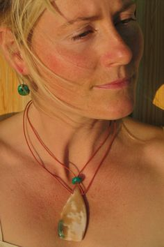 One of a kind, hand made Thulite pendant with Chrysocolla earrings.