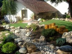 beautiful outdoor living spaces and garden design ideas  Look at the river rocks on their edges