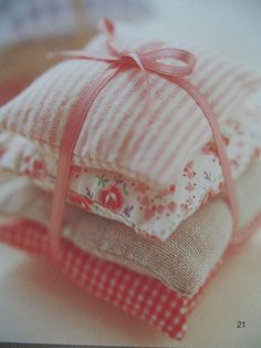 small pink sachet pillows fill with scented filling and toss in a closet. My grandmother use to do that!