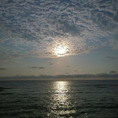 Sun sea and stratus clouds