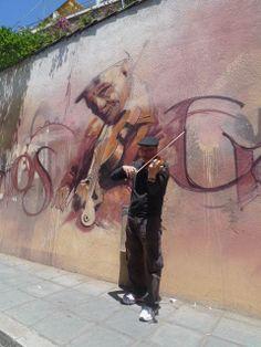 """a violin player""+ a violin player"