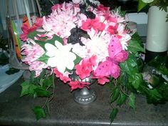 Pink, white, and a splash of black to off-set your centerpiece.  Add a butterfly or any choice of ornament