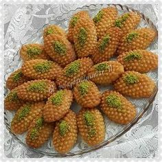 Image may contain: food Eid Sweets, Arabic Sweets, Arabic Food, Turkish Recipes, Greek Recipes, Turkish Sweets, Baklava Recipe, Sweet Sauce, Food Decoration