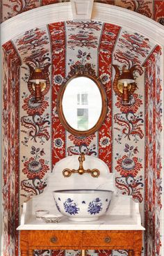 So beautiful! Love the paisley/stripe wallpaper and the blue & white floral bowl sink.