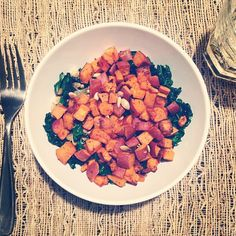 my go-to #dinner: roasted #sweetpotato w/ coconut oil + spices over sautéed #kale w/ onion + garlic. dressed in EVOO, dijon mustard, ACV, S+P, chia seeds + hemp seeds. topped it w/ toasted pine nuts + pumpkin seeds. easy + #delicious. #sashayogawellness #eatpurely #healthy #glutenfree #vegan