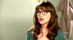 Zooey Deschanel bangs with round glasses