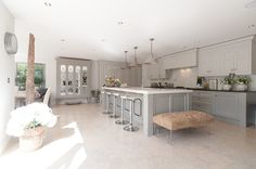 Transitional Kitchen by 50 Degrees North Architects Note the blend of grays.