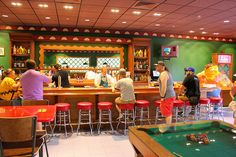 Krusty Burger, Moe's Tavern open at Universal Studios Orlando, where Simpsons Fast Food Boulevard offers a taste of Springfield, bringing guests into iconic locations from the classic animated TV series. Moe's Tavern, Krusty Burger, Cletus' Chicken Shack, the Frying Dutchman, Luigi's Pizza & more, all serving up previously fictional food and drinks-including Duff Beer.