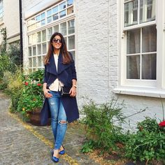 Mimi Ikonn | Navy waterfall trench coat, ripped jeans, blue flats
