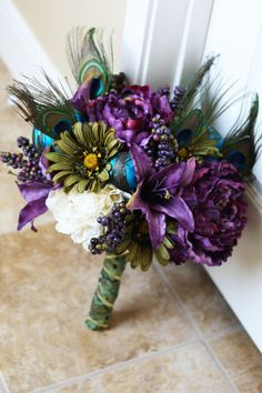 Purple Peacock Wedding Bridal Bouquet. $100.00, via Etsy.  I like the blue, purple and white but am not a fan of the peacock and green