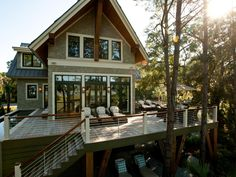 This home's elevated back deck offers plenty of space for a great view of the outdoors. Space under the deck offers more seating space.