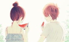 Today's GIF of the Day features a cute anime couple eating watermelon while sitting next to each other. First, they both are minding their own business, until the they both turn to look at each other. The boy then swiftly leans over and kisses the girl on the lips. How adorably romantic!