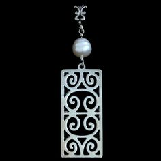 First Scots Grand Silver Charleston Gate Pendant from the Charleston Gates Collection at Charleston Jewelry and Gifts | The First Scots Grand Silver Charleston Gate Pendant design is inspired by the wrought iron double gate railing original to the gateway of the First Scots Presbyterian Church c. 1814 Charleston, SC. With a pearl and a fleur de lis bale, it really is a stunning piece from the Charleston Gate Collection that was hand crafted in Charleston, SC! charlestonjewelryandgifts.com