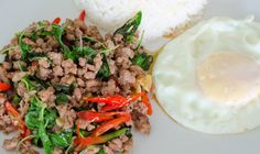 Phad Kaphraw (Meat or Seafood Fried with Sweet (Holy) Basil) - Phad Kaphraw is a 'to-go' Thai dish whenever you need a quick, tasty, pick me up. It's simple, readily available, and always hits the spot