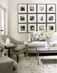 Small living room idea - black & white photos are wonderful, although the room itself is devastatingly bland