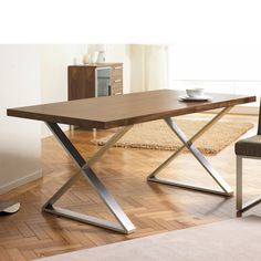 Crossed leg walnut dining table