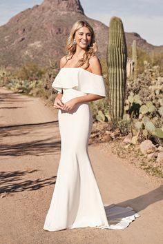 This stretch crepe fit and flare wedding dress is perfect for the casually cool bride. An off-the-shoulder flounce neckline becomes the focus of this clean look. With soft fabrics that will keep you comfortable all day long. Wedding Dress Styles, Dream Wedding Dresses, Boho Wedding Dress, Designer Wedding Dresses, Wedding Gowns, Lillian West, Bridal Elegance, Fit And Flare Wedding Dress, Allure Bridal