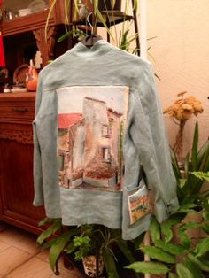 My first 'canvas'. Vintage painting appliqued to the back of a light blue linen jacket, with a tiny canvas also on the front  pocket. Theme is 'French villages'.