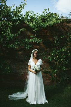 Bride wears a Charlie Brear Lace Dress | Photography by http://sdphotography.co.uk/