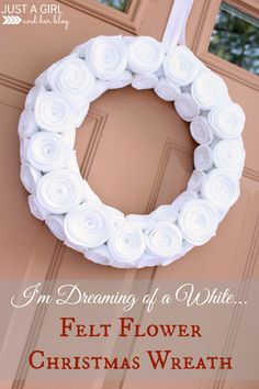 Stunning winter/Christmas wreath!! This would look beautiful on our front door! | Just a Girl and Her Blog