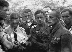 """Injured Major J.I. Antonov, Hero of the USSR,25,is surrounded by German pilots as he recounts his forced landing through an interpreter on Aug 25, 1942.German ace Gunther Rall recounted postwar that Antonov impressed the German pilots as a """"Mongolian race Russian"""" who did not look or act like a """"Mongolian.""""Antonov,Rall said, was not kept confined but was allowed to rest and circulate among his captors; """"he was a soldier like us.""""Antonov's eventual fate though remains unknown."""