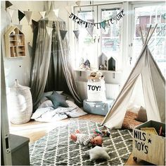 the boo and the boy: kids' rooms on instagram // reading nook with numero74 canopy, white tent, grey and white geometric rug, house shaped wall shelf, black and white pennant banner, crate of toys