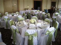 For a much classier look at the wedding - rent or buy (i.e. on ebay) white seat covers and tie satin sashes in the theme color around the back. So beautiful!  Picture from dm-weddings.com