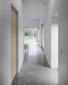Minimalist interior design with concrete floors and natural wood...