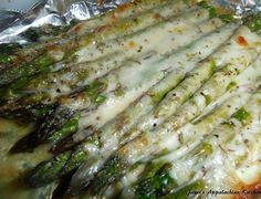 1 bunch of asparagus, woody ends trimmed 3 T. butter, melted 1/2 tsp. my house seasoning (equal parts garlic powder, onion powder and ...