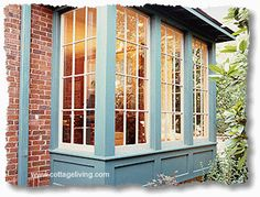 Bump out bay windows - a way to increase living space and give the kitties a place to watch the world