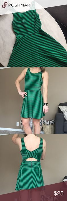 American Eagle Outfitters Mid-Thigh Length Dress Green with Navy/Black Stripes (I honestly can't tell what color they are). Worn once only for a couple hours! Wonderful condition. Comfiest dress I've ever worn with the cutest open back criss cross detail and a scoop neck. Looks beautiful with a statement necklace and a pair of wedges. Zipper on the side and in the back. Great dress for work, weddings, or any time. American Eagle Outfitters Dresses Midi
